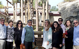 The Van Der Linden family pose in front of the Orangutan exhibit at the Audubon Zoo.