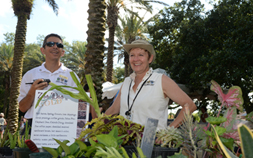 Volunteers in Audubon Horticulture smile while surrounded by various plants