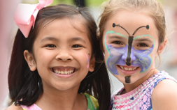2 small girls smile while attending the Zoo-to-Do for Kids event at Audubon Zoo.