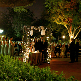 A bride and groom marry in a ceremony at the Audubon Tea Room in Audubon Park.