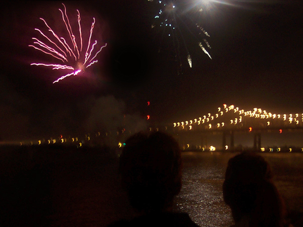 Fireworks shoot into the night sky over the Mississippi River in New Orleans.