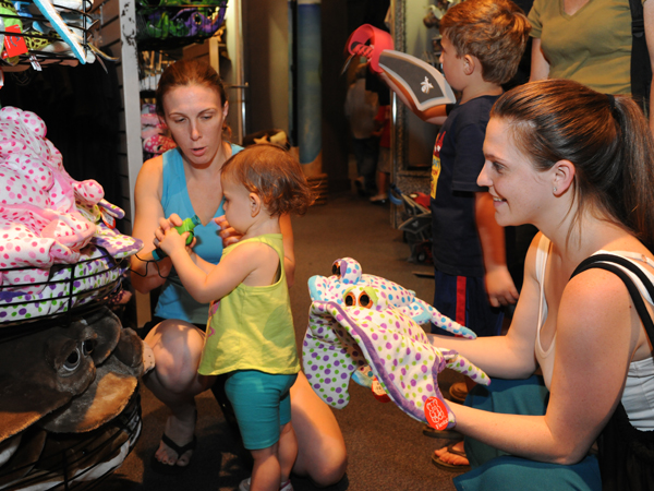 A family looks at items featured at the Treasure Chest Gift Shop in the Audubon Aquarium of the Americas.