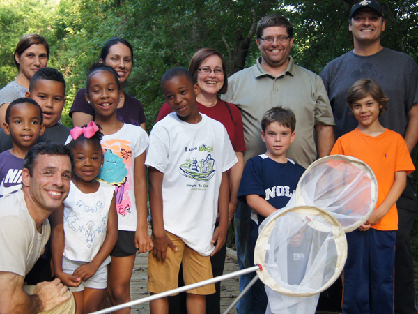A group of kids hold butterfly nets as part of the Wild Nights Insect Adventure at the Audubon Zoo.