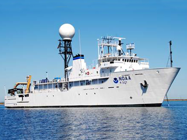 A large white NOAA ship on the Gulf of Mexico.