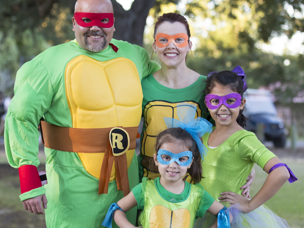 A family wearing Teenage Ninja Turtle Costumes attends Boo at the Zoo at the Audubon Zoo.