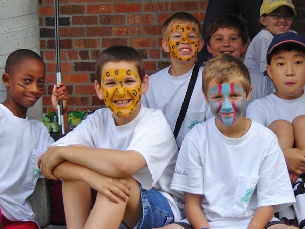 A group of boys with painted faces attend the Zoo Explorers Summer Camp at Audubon Zoo.