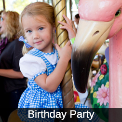 Icon for Birthday Party, featuring a little girl riding the Endangered Species Carousel at Audubon Zoo.