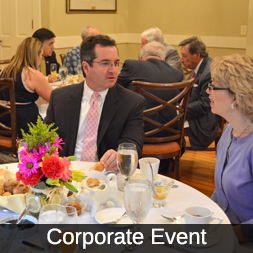 Icon for Corporate Events, featuring people in business dress sitting at set tables.