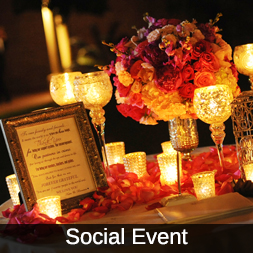 Icon for Social Events, photo includes flowers and candlelight.